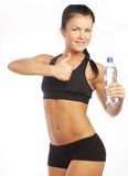 Sporty woman with bottle of water Royalty Free Stock Photography