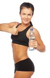 Sporty woman with bottle of water Stock Image