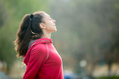 Sporty woman breathing fresh air Stock Photo