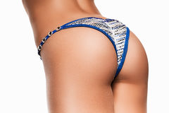 Sporty woman buttocks in blue and silver panties Stock Images