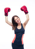 Sporty woman celebrating her victory in boxing gloves Royalty Free Stock Photo