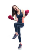 Sporty woman celebrating her victory in boxing gloves Stock Photos