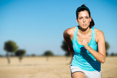 Sporty woman cross country running Royalty Free Stock Photos