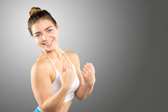 Sporty woman demonstrating biceps Royalty Free Stock Photo