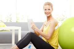 Sporty woman with digital tablet Royalty Free Stock Photography