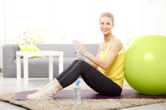 Sporty woman with digital tablet Stock Photos