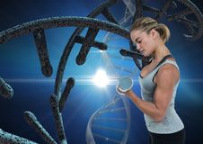 Sporty woman with dna chain and blue background Royalty Free Stock Photo