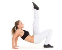 Sporty woman does exercises. Fitness. Royalty Free Stock Images