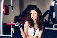 Sporty woman does the exercises stock photography