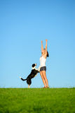 Sporty woman and dog celebrating workout success Royalty Free Stock Photo