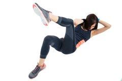 Sporty woman doing abdominal exercises. Isolatedo n a awhite background royalty free stock photography
