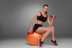 Sporty woman doing aerobic exercise Stock Photo