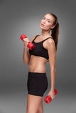 Sporty woman doing aerobic exercise Royalty Free Stock Photography