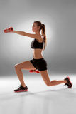 Sporty woman doing aerobic exercise Stock Images