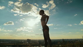 Sporty woman doing Ashtanga yoga in the park at sunset stock footage