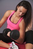 Sporty Woman Doing Biceps Exercise Stock Images