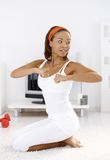 Sporty woman doing exercise Stock Image