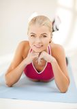 Sporty woman doing exercise on the floor Stock Photo