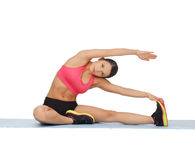 Sporty woman doing exercise on the floor Stock Photography
