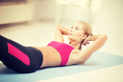 Sporty woman doing exercise on the floor Royalty Free Stock Photos