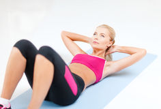 Sporty woman doing exercise on the floor Stock Image