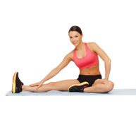 Sporty woman doing exercise on the floor Royalty Free Stock Photo