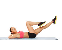 Sporty woman doing exercise on the floor Royalty Free Stock Photography