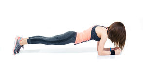 Sporty woman doing exercises on the floor Stock Photos