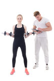 Sporty woman doing exercises with personal trainer isolated on w Stock Photo