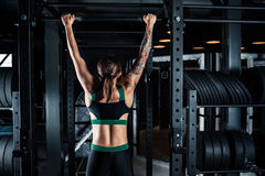 Sporty woman doing lifting up. On the gym royalty free stock photo
