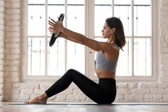 Young sporty attractive woman practicing pilates with a ring royalty free stock photos
