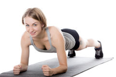 Sporty woman doing plank exercise Stock Photos