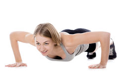 Sporty woman doing push-ups Royalty Free Stock Photo
