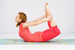Sporty woman doing stretching exercise Stock Photos