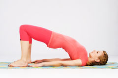 Sporty woman doing stretching exercise Royalty Free Stock Photos