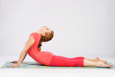 Sporty woman doing stretching exercise Stock Photo