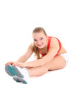 Sporty woman doing stretching exercise over white background Stock Photos