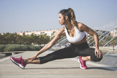 Sporty woman doing stretching exercises Royalty Free Stock Images