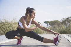 Sporty woman doing stretching exercises Royalty Free Stock Image