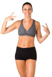 Sporty Woman Doing a Victory Sign Stock Photography