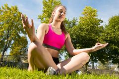 Sporty woman doing yoga in the park Stock Images