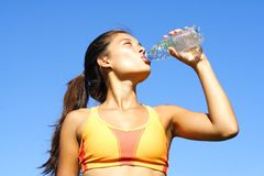Sporty woman drinking Royalty Free Stock Image