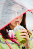 Sporty woman drinking detox healthy smoothie Royalty Free Stock Photos