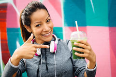 Sporty woman drinking detox smoothie Royalty Free Stock Image