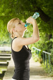 Sporty woman drinking water Stock Photography
