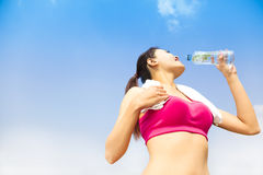 Sporty woman drinking water  bottle after jogging or running Royalty Free Stock Photo