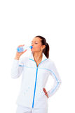 Sporty woman drinking water Stock Photo