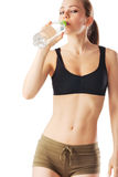 Sporty woman drinking water. Isolated on white Royalty Free Stock Photo
