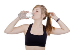 Sporty woman drinking water Stock Photos