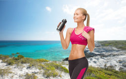 Sporty woman drinking water from sportsman bottle Royalty Free Stock Image